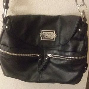 Black Nicole Miller purse.